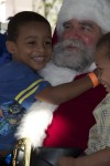 Santa Claus greets the children at Governor and Mrs. de Jongh's Annual Children Holiday Party
