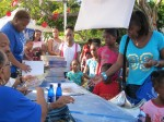 """Tregenza A. Roach, author of """"The Lesson Box"""" signs books for the children."""