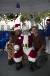 "Santa Claus poses with his ""elf"" and Mario"