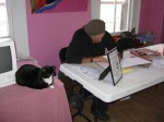 Author Mario Picayo signs A Very Smart Cat, next to one of Animalkind's residents. The similarity with the cat on the cover of the book is purely coincidental. We did not place the cat as a prop. Honest!