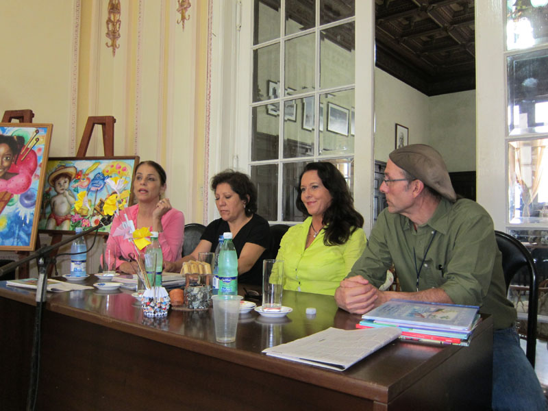 Mario Picayo with colleages, Edna Iturralde of Ecuador. Liliana de la Quintana of Bolivia, and Irene de Delgado of Panama, during  the yearly event title Merienda de Locos (Mad Hatter's Tea Party).  The event brings together some of the best writers and publishers of children's literature from around the world for a series of theoretical round tables and panels.