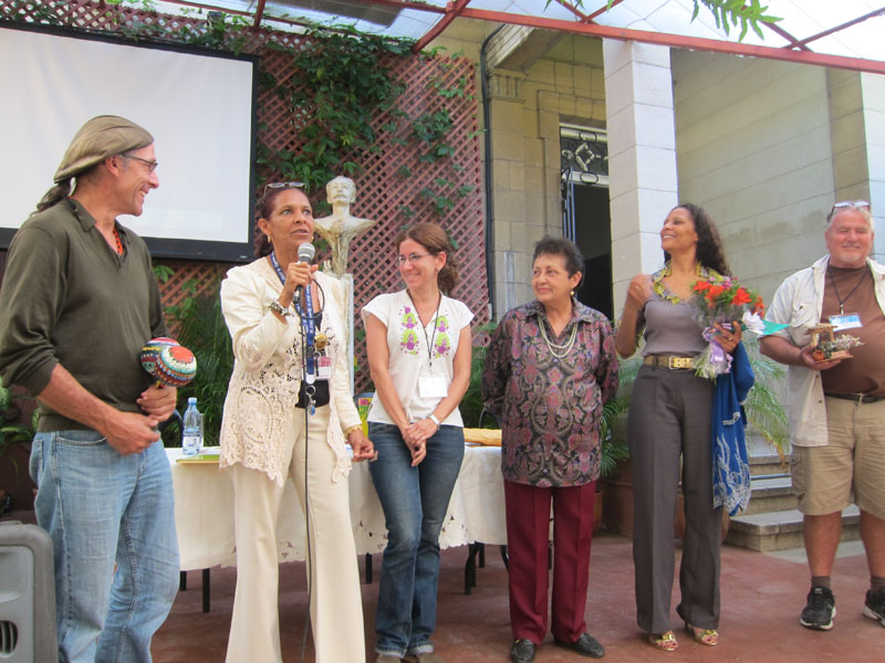 "A ""Thank you"" from Gente Nueva to visiting authors. From left: Mario Picayo,  Flor Nodal Montalvo (Editorial Gente Nueva) , Denise Ocampo (Gente Nueva) writers Loekie Morales, with flowers (St. Maarten) and Leo Regals (Curacao)."