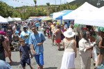 Cruz Bay, St John during carnival. Governor de Jongh's Summer Reading Challenge tent and staff joined the festivities