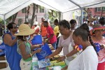 Sekoia Rogers (wearing the hat) hands out books at the 2012 Summer Reading Challenge event, St John, U.S. Virgin Islands