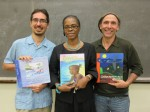 Campanita author's Rafael Landrón, Alscess Lewis-Brown, and Mario Picayo proudly pose with their creations.