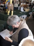 Yolanda signs a copy of the book.