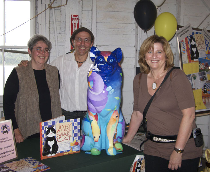"Illustrator Yolanda Fundora, author Mario Picayo, ""Cat Tales"" cat and her smiling new owner Sharon Eisen"