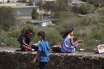 Kids enjoy the day from the top of the fort.