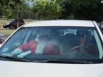 St Croix, USVI- Too hot for the reindeers, Santa gets a ride in an air conditioned car.