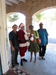 "Our publisher Mario Picayo with Santa Claus and Alscess Lewis-Brown, author of ""Efa and the Mosquito"""
