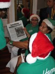 "St. Croix, USVI- ""Elves"" read a newspaper article about Mario's book presentation at Undercover Bookstore."