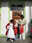 Cecile de Jongh, First Lady of the U.S. Virgin Islands gives Santa a hand
