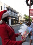 "Santa's helper reads Mario's ""A Caribbean Journey fromA to Y"" on Main Street, St Thomas."
