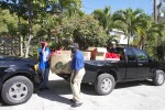Santa's helpers unloading not a sleigh (too hot for reindeers in the Virgin Islands, but a truck-full of gits)