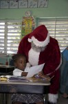 Santa reads a letter to him, from a young student at St John Christian Academy