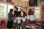 Santa Claus poses with teachers, students and the First Lady of the U.S. Virgin Islands at St John Christian Academy