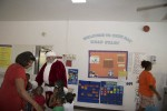 Little ones greet Santa and the First Lady at the Cruz Bay Head Start