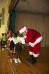 A young student tells Santa what she wants for Christmas. Pearl B. Larsen Elementary School, St Croix.