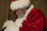 Santa and a student after discussing Christmas wishes. Pearl B. Larsen Elementary School, St Croix.