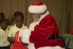 Santa hands out gift bags to the children of the Pearl B. Larsen Elementary School, St Croix.