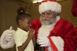 A very excited student meets Santa Claus. Pearl B. Larsen Elementary School, St Croix.
