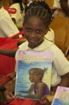 "Happily posing with her just-received copy of ""Efa and the Mosquito"" Pearl B. Larsen Elementary School, St Croix."