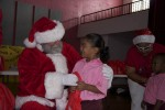 Santa and a student share a moment. Juanita Gardine Elementary School, St. Croix 2321- Kids patiently and politely wait their turn to talk to Santa.