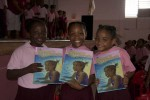 "Three smiles, three copies of ""Efa and the Mosquito"" Juanita Gardine Elementary School, St. Croix"