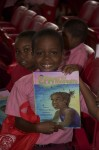 "A student shows us his copy of ""Efa and the Mosquito"". Juanita Gardine Elementary School, St. Croix"
