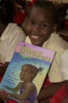 "Posing with his new book ""Efa and the Mosquito"". E. Benjamin Oliver Elementary School on St. Thomas"