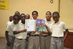 "Students from the E. Benjamin Oliver Elementary School on St Thomas pose with ""A Caribbean Journey from A to Y"""