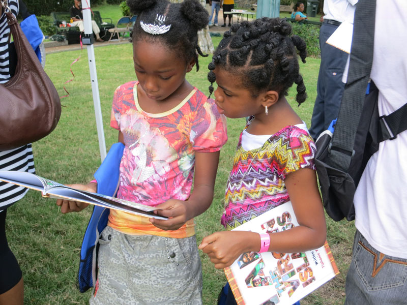 Looking at their new book.