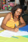 "Ashley-Ruth Moolenaar Bernier, author of ""Sand Sea and Poetry"", signs books at the Tutu Park Mall in St. Thomas."