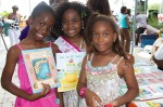 Young readers pose with their new books.