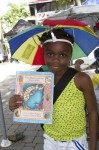 A young reader stays cool and poses with her new book.